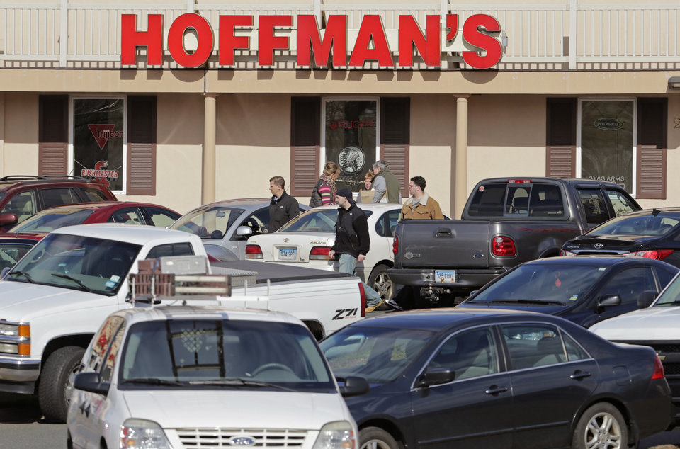 Cars jam the parking lot as shoppers leave Hoffman\'s Gun Center with their purchases in Newington, Conn., Tuesday, April 2, 2013. Customers are packing gun stores around Connecticut following the unveiling of new gun-control legislation, which could take effect as soon as Wednesday evening. (AP Photo/Charles Krupa)