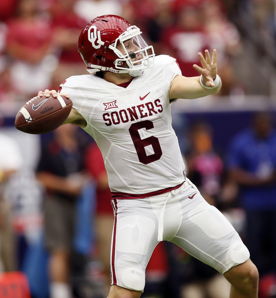 Photo - Oklahoma's Baker Mayfield (6) passes during the AdvoCare Texas Kickoff college football game between the University of Oklahoma Sooners (OU) and the Houston Cougars at NRG Stadium in Houston, Saturday, Sept. 3, 2016. Photo by Nate Billings, The Oklahoman