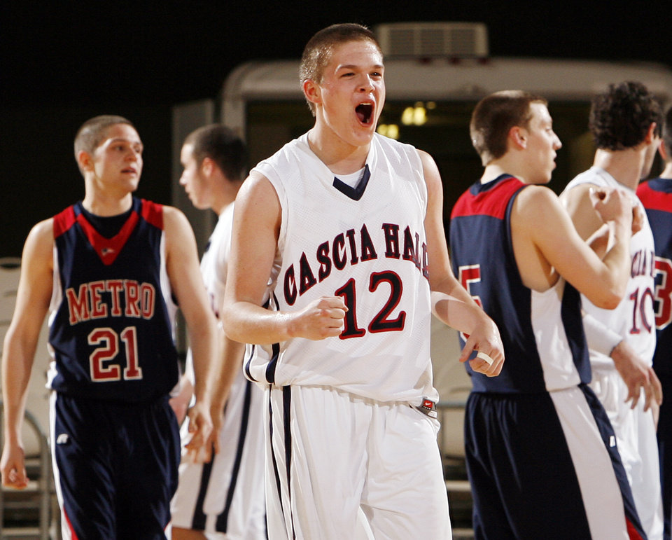 Photo - Cascia Hall's Stephen Rouse (12) reacts in front of Metro Christian's Spencer Campbell (21) and Cliff Hughes (5) late in the fourth quarter during the 3A boys semifinal game between Metro Christian and Cascia Hall in the Oklahoma High School Basketball Championships at State Fair Arena in Oklahoma City, Friday, March 13, 2009. Cascia Hall won, 52-50. PHOTO BY NATE BILLINGS, THE OKLAHOMAN