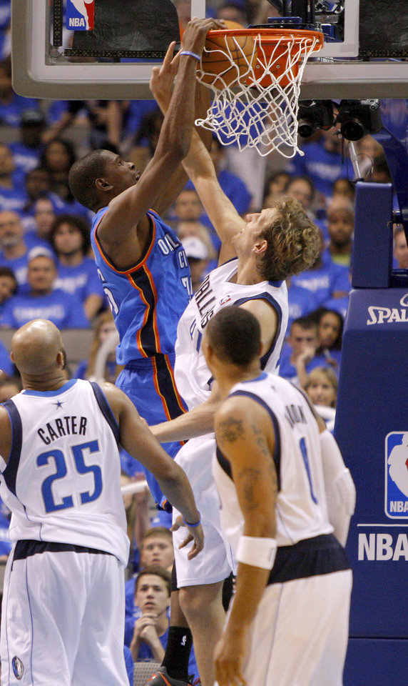 Photo - Oklahoma City's Kevin Durant (35) dunks the ball over Dallas' Dirk Nowitzki (41) during Game 3 of the first round in the NBA playoffs between the Oklahoma City Thunder and the Dallas Mavericks at American Airlines Center in Dallas, Thursday, May 3, 2012. Oklahoma City won 95-79. Photo by Bryan Terry, The Oklahoman