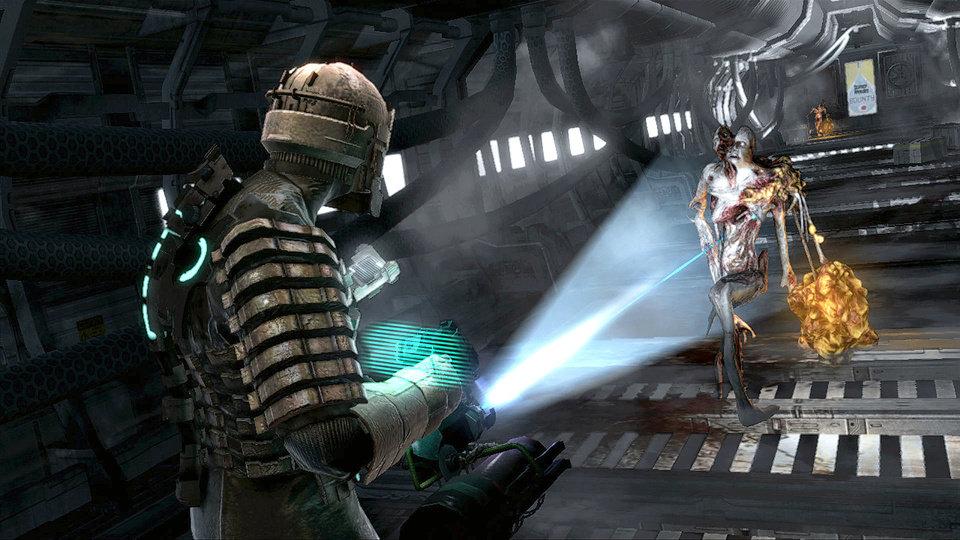 Photo - An engineer investigates an alien infestation aboard a mining ship in Dead Space.  AP PHOTO