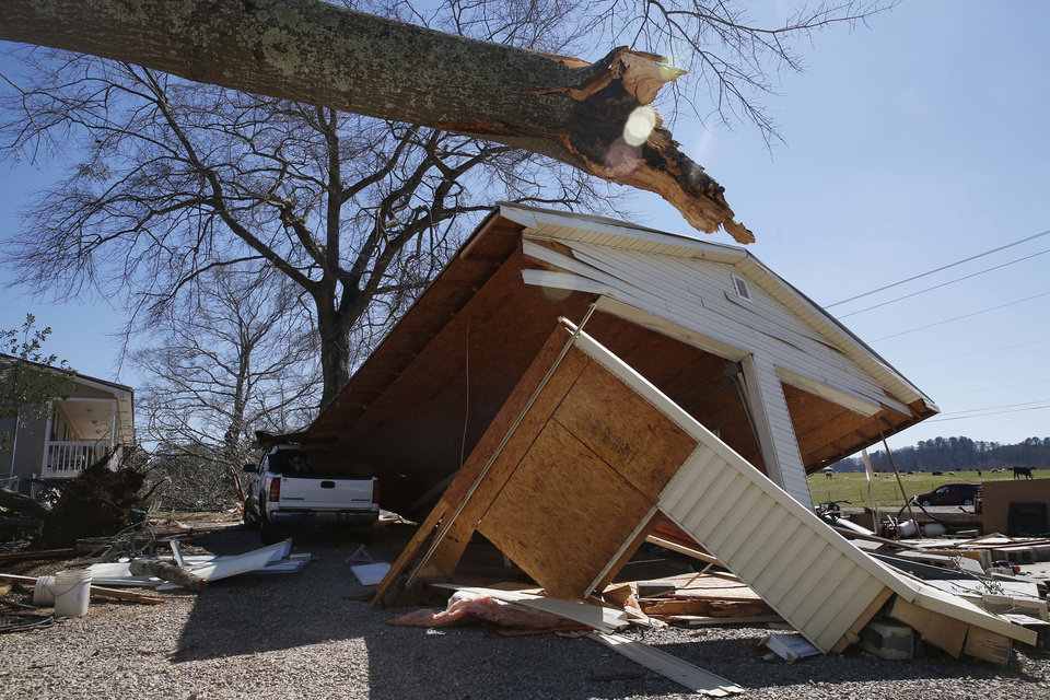 Photo - A garage shows damage, on Wednesday, March 2, 2016, from storms that struck Tuesday evening in Bessemer, Ala.  Forecasters say a tornado that severely damaged homes and trees in the Birmingham suburb has been determined as an EF2, with winds of between 120 and 125 mph.  (AP Photo/Brynn Anderson)