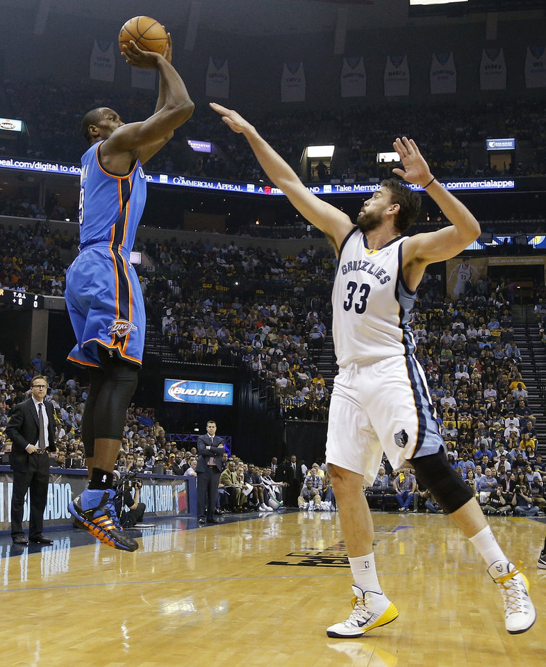 Photo - Oklahoma City's Serge Ibaka (9) shoots against Memphis' Marc Gasol (33) during Game 4 in the first round of the NBA playoffs between the Oklahoma City Thunder and the Memphis Grizzlies at FedExForum in Memphis, Tenn., Saturday, April 26, 2014. Photo by Bryan Terry, The Oklahoman