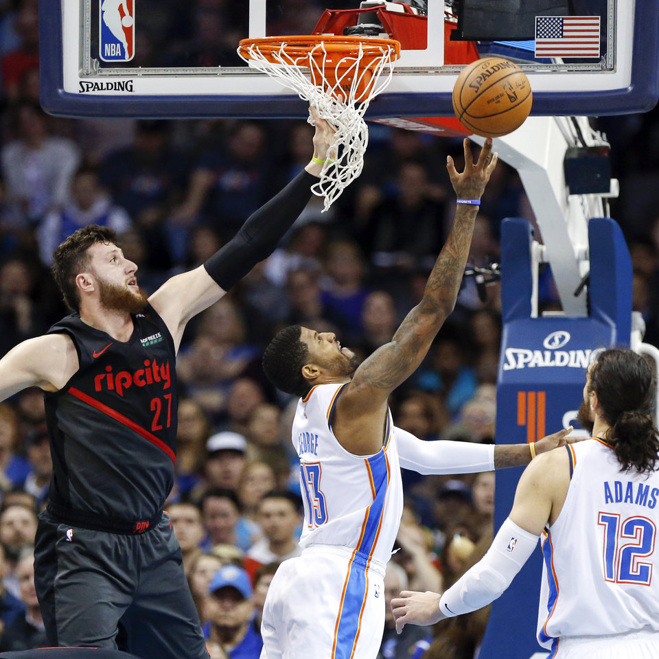 Photo - Oklahoma City's Paul George (13) shoots in front of Portland's Jusuf Nurkic (27) in the first quarter during an NBA basketball game between the Portland Trail Blazers and the Oklahoma City Thunder at Chesapeake Energy Arena in Oklahoma City, Monday, Feb. 11, 2019. Photo by Nate Billings, The Oklahoman