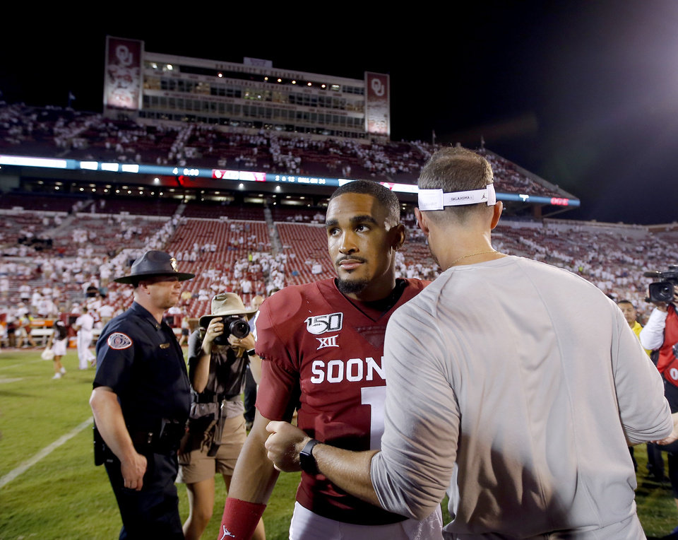 Photo - Oklahoma head coach Lincoln Riley talks with Oklahoma's Jalen Hurts (1) following a college football game between the University of Oklahoma Sooners (OU) and the Houston Cougars at Gaylord Family-Oklahoma Memorial Stadium in Norman, Okla., Sunday, Sept. 1, 2019. [Sarah Phipps/The Oklahoman]