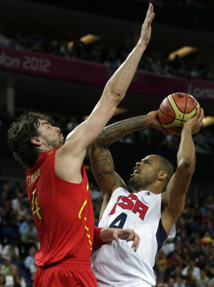 United States' Tyson Chandler shoots over Spain's Pau Gasol during the men's gold medal basketball game at the 2012 Summer Olympics, Sunday, Aug. 12, 2012, in London. (AP Photo/Charles Krupa)