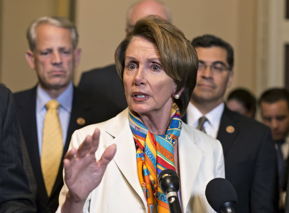 Photo - House Minority Leader Nancy Pelosi, D-Calif., center, and House Democratic leaders speak to reporters just before midnight at the Capitol in Washington, Monday, Sept. 30, 2013. For the first time in nearly two decades, the federal government staggered into a partial shutdown Monday at midnight after congressional Republicans stubbornly demanded changes in the nation's health care law as the price for essential federal funding and President Barack Obama and Democrats adamantly refused. Joining Pelosi, from left, are Rep. Steve Israel, D-N.Y., and Rep. Xavier Becerra, D-Calif.  (AP Photo/J. Scott Applewhite)