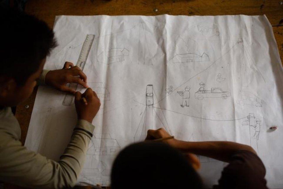 Photo -  Boys in Sillab, Guatemala, work on their version of plans for electrifying their rural village.