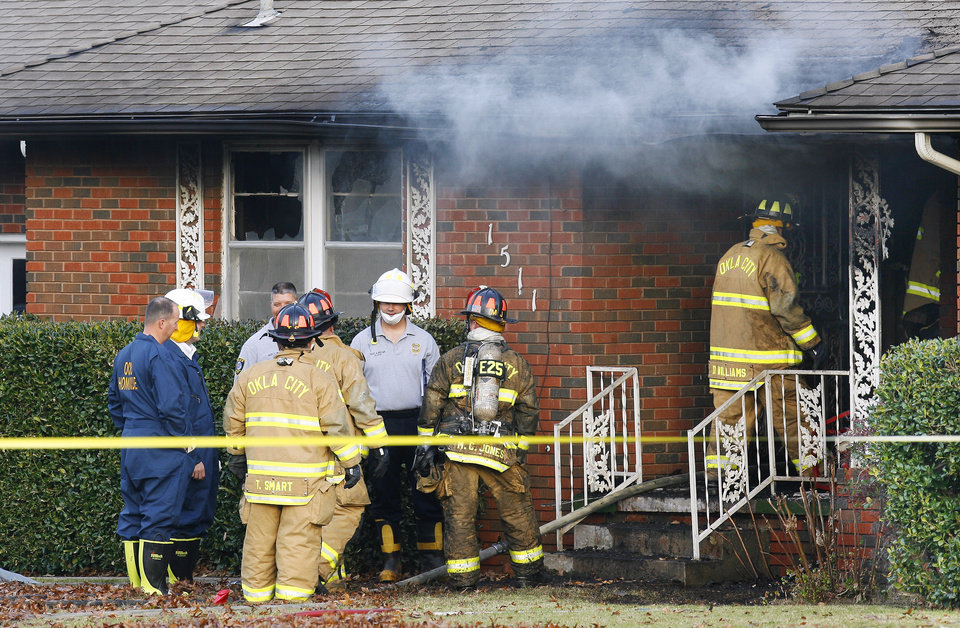 Photo - DEATHS / FATAL / ARSON: Oklahoma City firefighters and police investigate a fatality house fire at 1511 SW 56 Street in Oklahoma City Monday, Nov. 9, 2009. Photo by Paul B. Southerland, The Oklahoman ORG XMIT: KOD