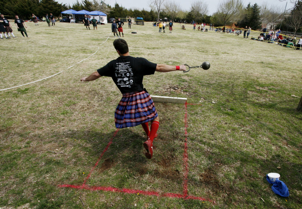 Chad Justin, Lawrence, Kansas, competes in the weight for distance at the Iron Thistle Scottish Heritage Festival and Highland Games at the Kirkpatrick Family Farm in Yukon Saturday March 21, 2009. Photo by Doug Hoke, The Oklahoman.