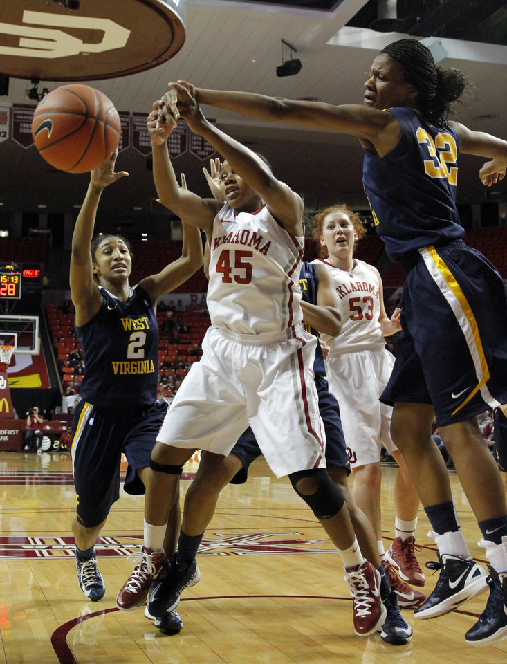 Photo - West Virginia Mountaineers' Taylor Palmer (2) and Crystal Leary (32) fight Oklahoma Sooner's Jasmine Hartman (45) for a rebound as the University of Oklahoma Sooners (OU) play the West Virginia Mountaineers in NCAA, women's college basketball at The Lloyd Noble Center on Wednesday, Jan. 2, 2013  in Norman, Okla. Photo by Steve Sisney, The Oklahoman