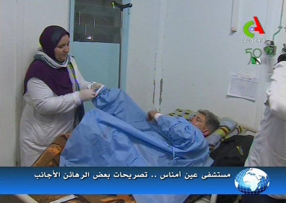 Photo - An unidentified rescued hostage receives treatment in a hospital in Ain Amenas, Algeria, in this image taken from television  Friday Jan. 18, 2013. Algeria's state news service says nearly 100 out of 132 foreign hostages have been freed from a gas plant where Islamist militants had held them captive for three days.  The APS news agency report was an unexpected indication of both more hostages than had previously been reported and a potentially breakthrough development in what has been a bloody siege. (AP Photo/Canal Algerie  via Associated Press TV)  **  TV OUT   ALGERIA OUT  **