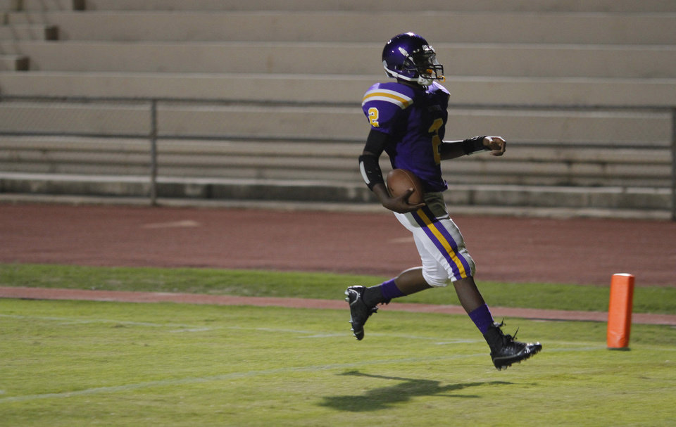NWC's Fre'Darian Ashley scores a touchdown after a catch just before the half all alone at the Northwest Classen vs. Western Heights high school football game at Taft Stadium Thursday, September 20, 2012. Photo by Doug Hoke, The Oklahoman