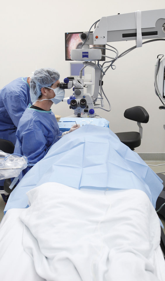 Dr. Ralph Hester performs cataract surgery in August at the Harold Hamm Oklahoma Diabetes Center in Oklahoma City. Photo By Steve Gooch, The Oklahoman
