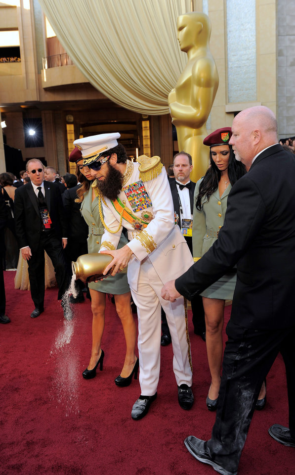 Sacha Baron Cohen drops a substance on the red carpet as he arrives before the 84th Academy Awards on Sunday, Feb. 26, 2012, in the Hollywood section of Los Angeles. (AP Photo/Chris Pizzello) ORG XMIT: OSC258