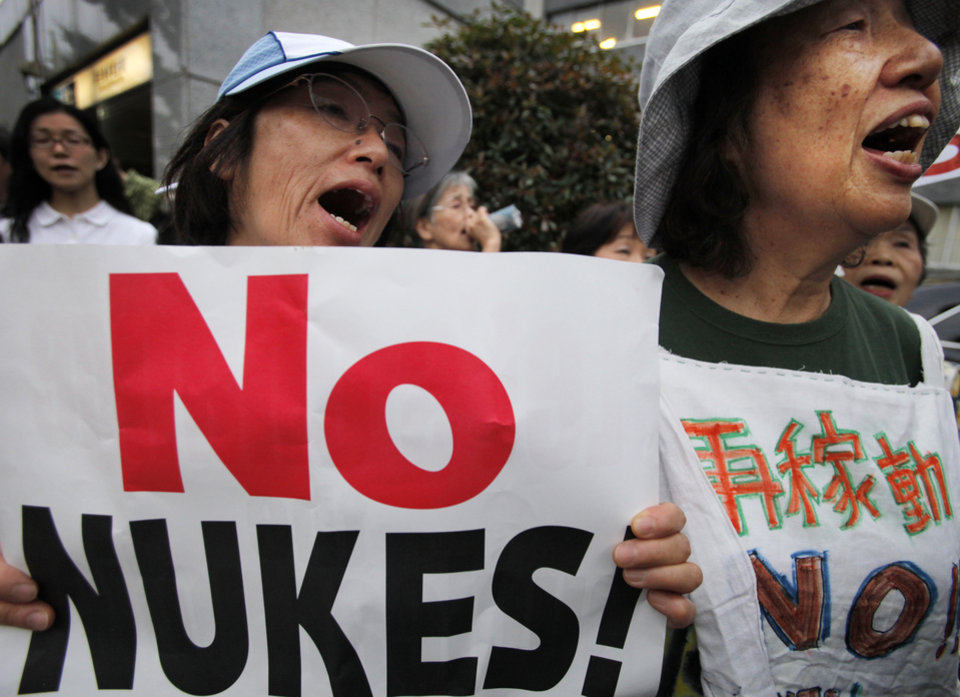 FILE - In this June 8, 2012 file photo, protesters shout slogans during an anti-nuclear plant rally in front of the Prime Minister's office in Tokyo shortly after Japanese Prime Minister Yoshihiko Noda said Japan must restart two nuclear reactors to protect the economy and people's livelihoods in a news conference. More than 20 months after a catastrophic nuclear disaster, massive protests against atomic energy and public opinion polls backing the phase-out of reactors, a pro-nuclear party won Japan's parliamentary election. The result left anti-nuclear proponents in shock Monday, Dec. 17, struggling to understand how the Liberal Democratic Party not only won, but won in a landslide. (AP Photo/Itsuo Inouye, File)