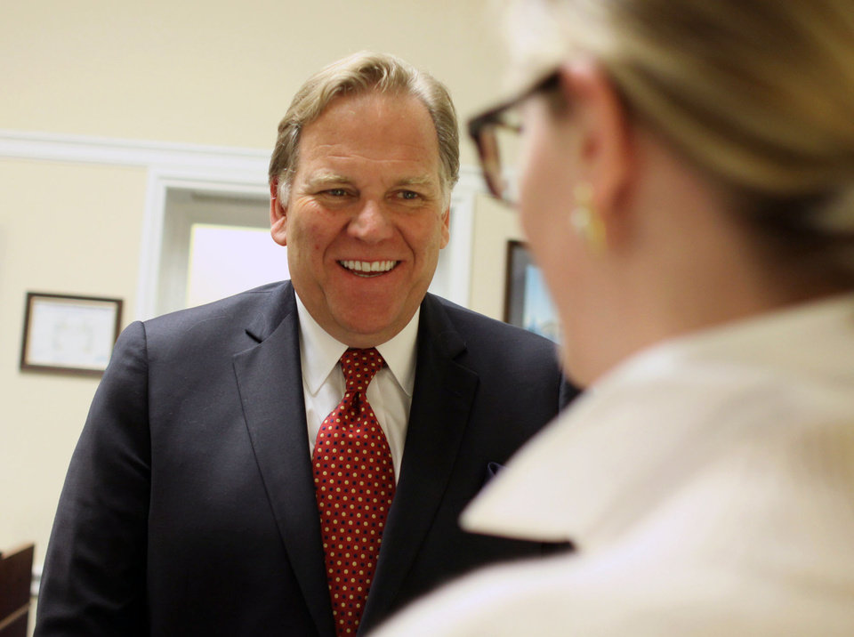 """Photo - In this April 30, 2014 photo, Rep. Mike Rogers, R-Mich, smiles in his office on Capitol Hill in Washington. The daily radio show Rogers begins hosting in January will give the Michigan Republican practice talking to millions of Americans every day, and honing what he calls a """"productive conservative"""" message talk radio is desperately lacking, he said. (AP Photo/Lauren Victoria Burke)"""