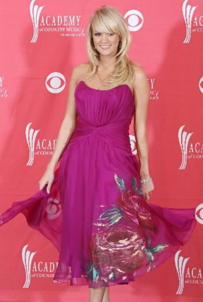 Photo -  Oklahoma native Carrie Underwood poses at the 2008 Academy of Country Music Awards. (Associated Press photo)