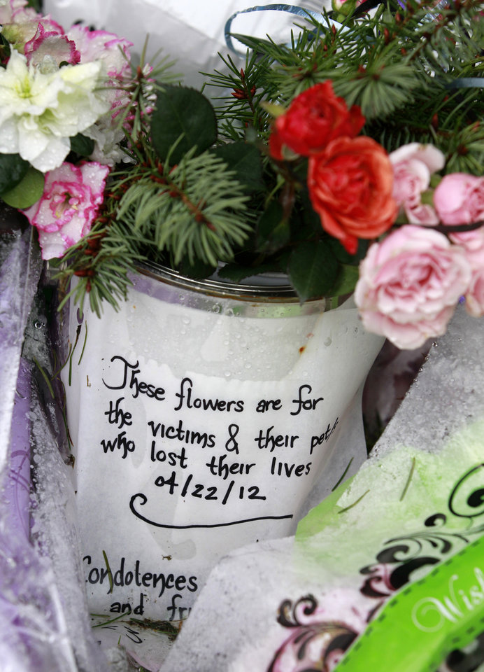 Photo -   Flowers sit as a make-shift shrine outside the burned-out home where a gun-toting survivalis is suspected of killing his wife and daughter several days earlier Friday, April 27, 2012, in North Bend, Wash. Peter Alex Keller may be holed up in a self-made fort not far from where Seattle's outer suburbs give way to the vast recreational playground of Cascade Mountains. Police expect more people to hit the nearby trails this weekend, and deputies are warning them to steer clear of Keller if they think they see him. (AP Photo/Elaine Thompson)