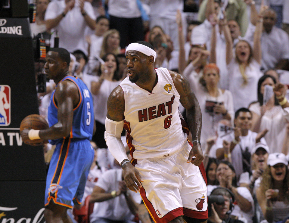 Photo - The crowd reacts after Miami's LeBron James (6) made a basket as Oklahoma City's Kendrick Perkins (5) watches during Game 3 of the NBA Finals between the Oklahoma City Thunder and the Miami Heat at American Airlines Arena, Sunday, June 17, 2012. Photo by Bryan Terry, The Oklahoman