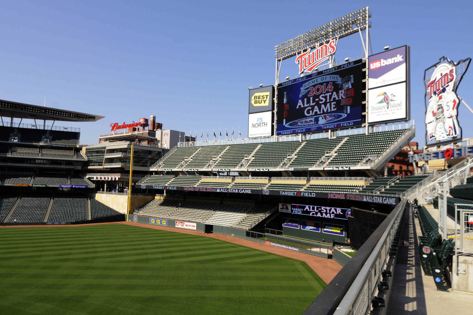 Photo - FILE - In this Aug. 29, 2012 file photo, a message showing that the Minnesota Twins will host the 2014 All-Star game at Target Field in Minneapolis is displayed on an outfield video screen after Commissioner Bud Selig made the announcement. Major League Baseball's All Star festivities will be held in the 4-year-old ballpark, the one that helped outdoor baseball make a return to chilly Minnesota.  (AP Photo/Jim Mone, File)