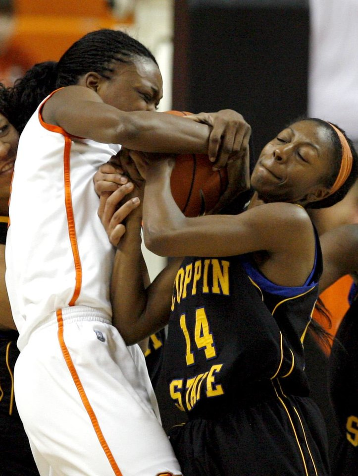 Photo - Oklahoma State's Toni Young (15) fights Coppin State's Ashle Craig (14) for the ball during the women's college game between Oklahoma State University and Coppin State at Gallagher-Iba Arena in Stillwater, Okla.,  Saturday, Nov. 26, 2011.  Photo by Sarah Phipps, The Oklahoman