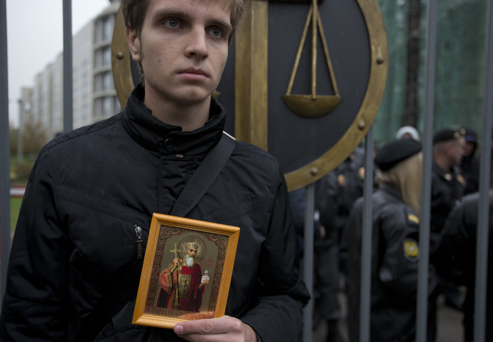 Photo -   An Orthodox believer protests outside a court in Moscow, Wednesday. Oct. 10, 2012. Three members of the punk band Pussy Riot are set to make their case before a Russian appeals court that they should not be imprisoned for their irreverent protest against President Vladimir Putin. (AP Photo/Alexander Zemlianichenko)