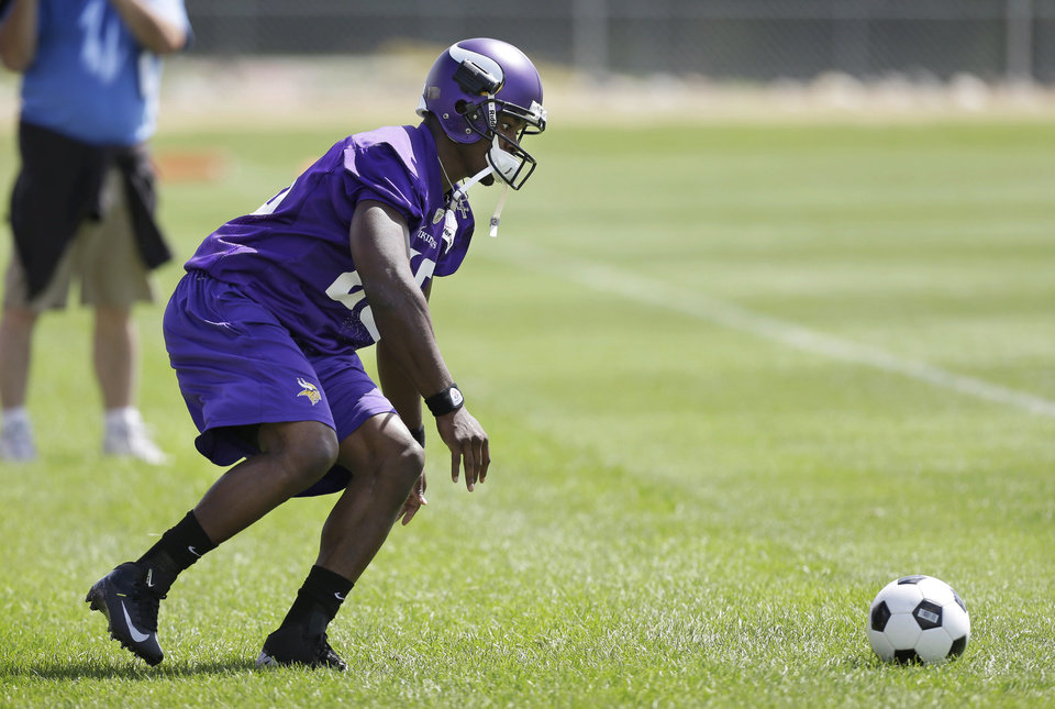 Looks like Emmit Smith's NFL rushing record isn't all Minnesota's Adrian Peterson is going after. Maybe he's taking up soccer, too? Nah, just a drill the former Sooner was during training camp in Mankato, Minn. (AP PHOTO)