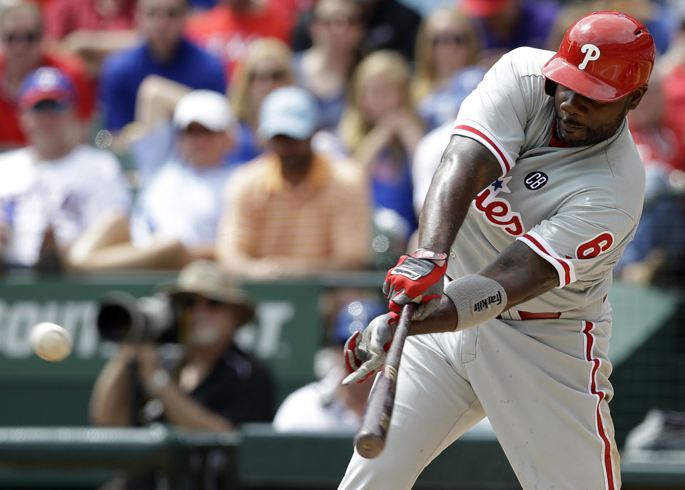 Photo - Philadelphia Phillies' Ryan Howard (6) singles against the Texas Rangers during the third inning of an opening day baseball game at Globe Life Park, Monday, March 31, 2014, in Arlington, Texas.  (AP Photo/Tony Gutierrez)