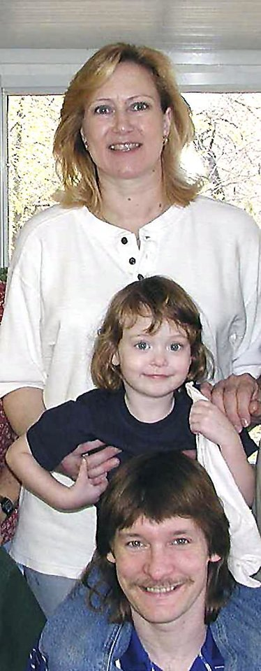 Darrell and Janice Wilcoxson pose for a photograph with their daughter, Stephanie. This photograph was taken  before Darrell committed suicide in 2005.  Photo provided by  Don and Kay Wilcoxson