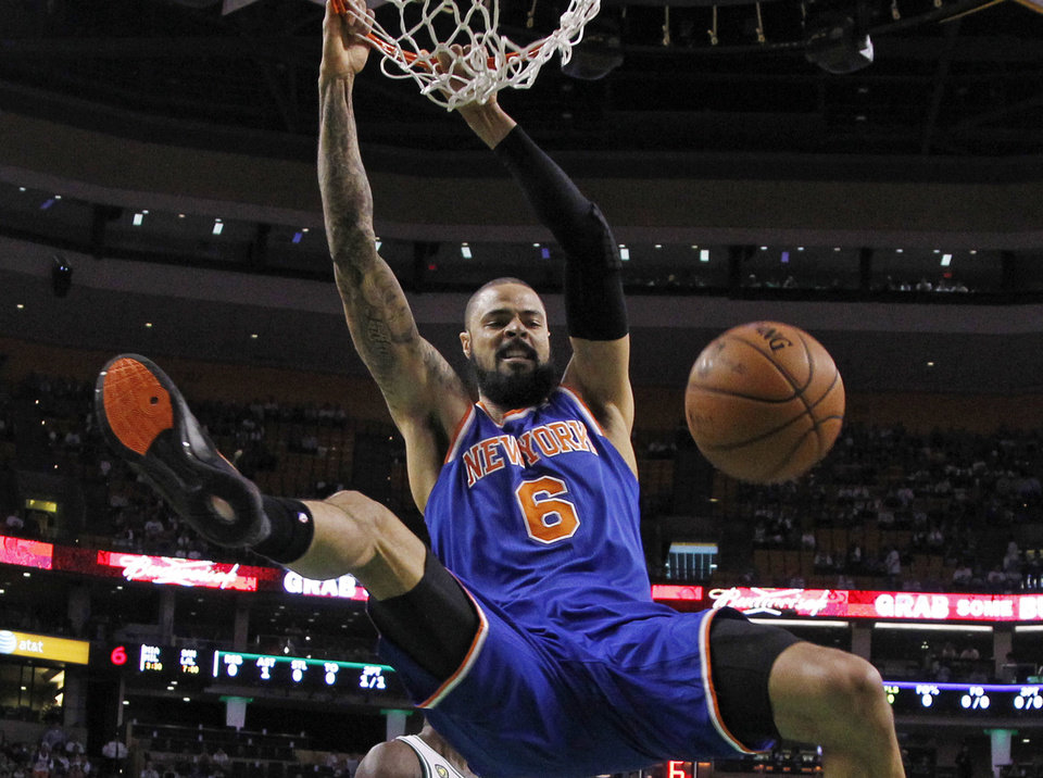 Photo - New York Knicks center Tyson Chandler (6) dunks against the Boston Celtics during the first half in Game 4 of a first-round NBA basketball playoff series in Boston, Sunday, April 28, 2013. (AP Photo/Elise Amendola)