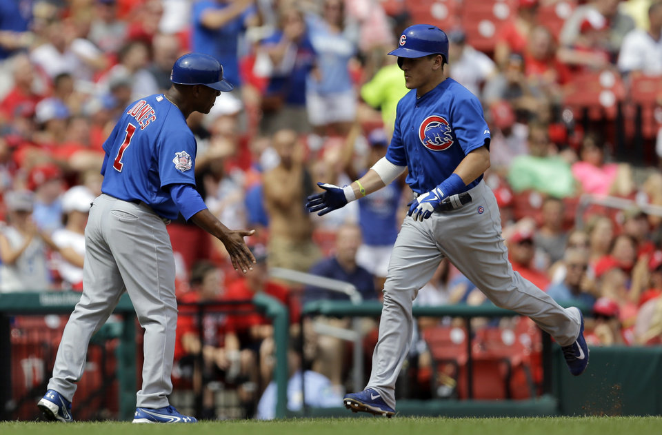 Photo - Chicago Cubs' Logan Watkins, right, is congratulated by third base coach Gary Jones while rounding the bases after hitting a solo home run during the fourth inning in the first baseball game of a doubleheader against the St. Louis Cardinals, Saturday, Aug. 30, 2014, in St. Louis. (AP Photo/Jeff Roberson)