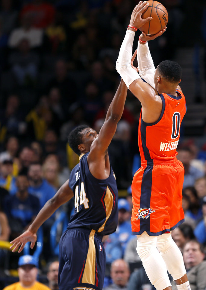 Photo - Oklahoma City's Russell Westbrook (0) shoots a 3-point as New Orleans' Solomon Hill (44) defends late in the fourth quarter during the NBA game between the Oklahoma City Thunder and the New Orleans Pelicans at the Chesapeake Energy Arena,  Sunday, Dec. 4, 2016. Photo by Sarah Phipps, The Oklahoman