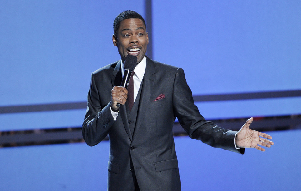 Photo - Host Chris Rock speaks on stage at the BET Awards at the Nokia Theatre on Sunday, June 29, 2014, in Los Angeles. (Photo by Chris Pizzello/Invision/AP)
