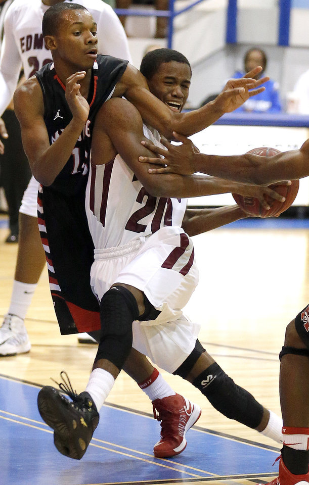 Edmond Memorial's Aaron Young tries to get by Mustang's Terrell Williams during the boys high school basketball game between Mustang and Edmond Memorial at the Bruce Gray Invitational at Deer Creek High School, Saturday,Jan. 26, 2013.Photo by Sarah Phipps, The Oklahoman