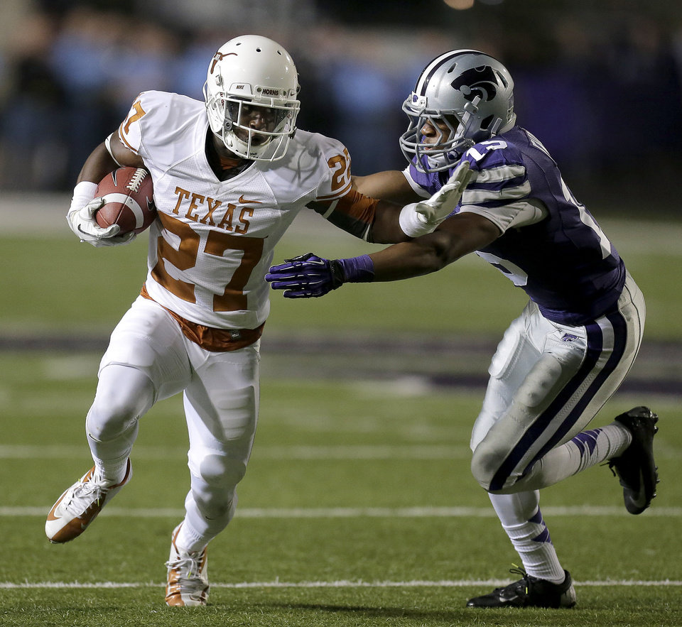 Photo - Texas wide receiver Michael Zaring (27) is pursued by Kansas State defensive back Randall Evans (15) during the first half of an NCAA college football game on Saturday, Dec. 1, 2012, in Manhattan, Kan. (AP Photo/Charlie Riedel)