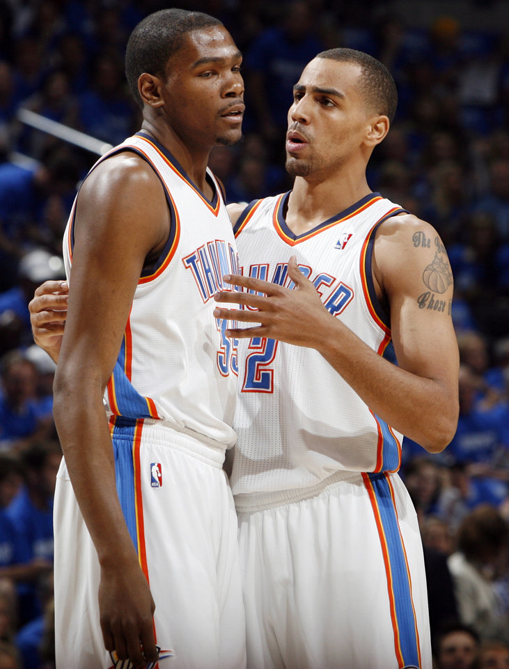 Photo - Oklahoma City's Thabo Sefolosha (2), right, talks to Kevin Durant (35) in the first half during game one of the Western Conference semifinals between the Memphis Grizzlies and the Oklahoma City Thunder in the NBA basketball playoffs at Oklahoma City Arena in Oklahoma City, Sunday, May 1, 2011. Photo by Nate Billings, The Oklahoman