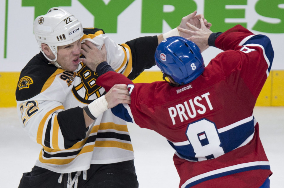 Photo - Boston Bruins' Shawn Thornton (22)  and Montreal Canadiens' Brandon Prust square off during second period NHL hockey action Thursday, Dec. 5, 2013, in Montreal. (AP Photo/The Canadian Press, Paul Chiasson)