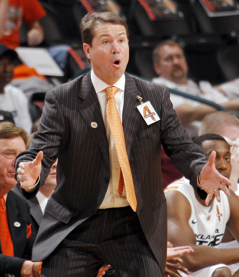 Photo - OSU head coach Travis Ford reacts to a call in the first half during the Bill Russell men's college basketball game of the Ramada All-College Classic between the Oklahoma State University Cowboys and the University of New Mexico Lobos at the Chesapeake Energy Arena in Oklahoma City, Saturday, Dec. 17, 2011. Photo by Nate Billings, The Oklahoman