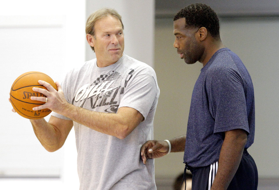 Photo - Kurt Rambis and Mark Bryant talk during the Thunder's practice in Oklahoma City, Sunday, Dec. 11, 2011. Photo by Sarah Phipps, The Oklahoman