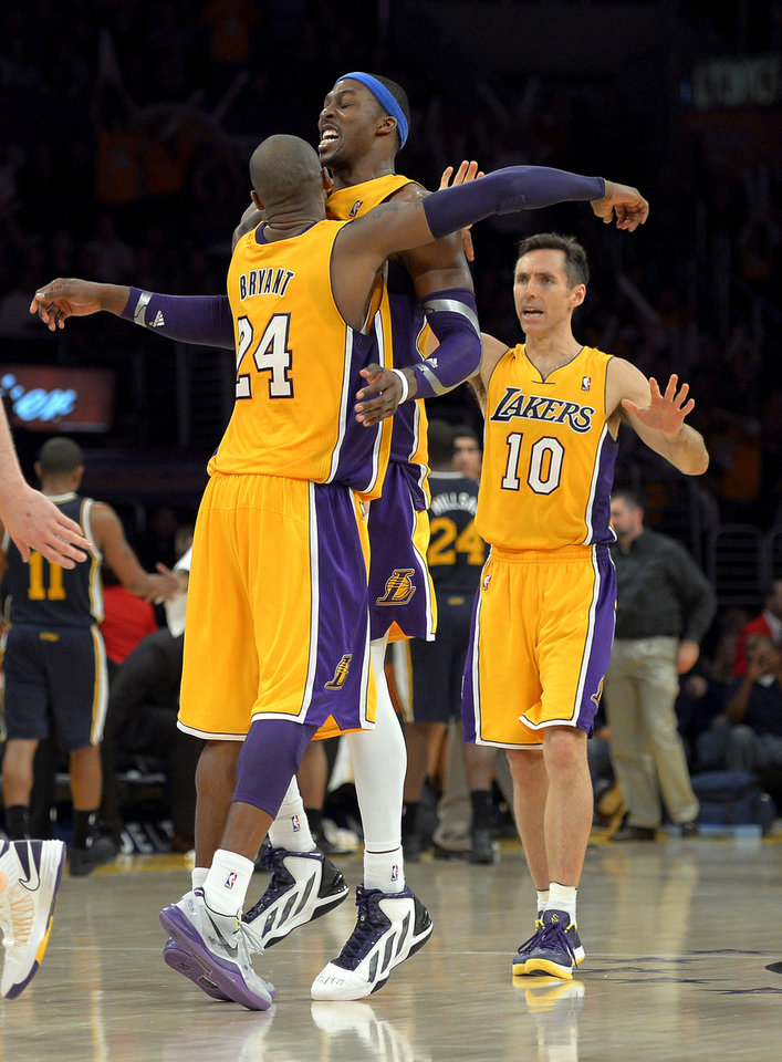 Photo - Los Angeles Lakers guard Kobe Bryant, left, and center Dwight Howard, center, celebrates along with guard Steve Nash during the second half of their NBA basketball game against the Utah Jazz, Friday, Jan. 25, 2013, in Los Angeles. The Lakers won 102-84. (AP Photo/Mark J. Terrill)
