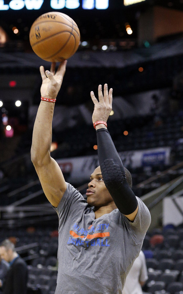 Photo - Oklahoma City's Russell Westbrook (0) shoots baskets before Game 5 of the Western Conference Finals in the NBA playoffs between the Oklahoma City Thunder and the San Antonio Spurs at the AT&T Center in San Antonio, Thursday, May 29, 2014. Photo by Sarah Phipps