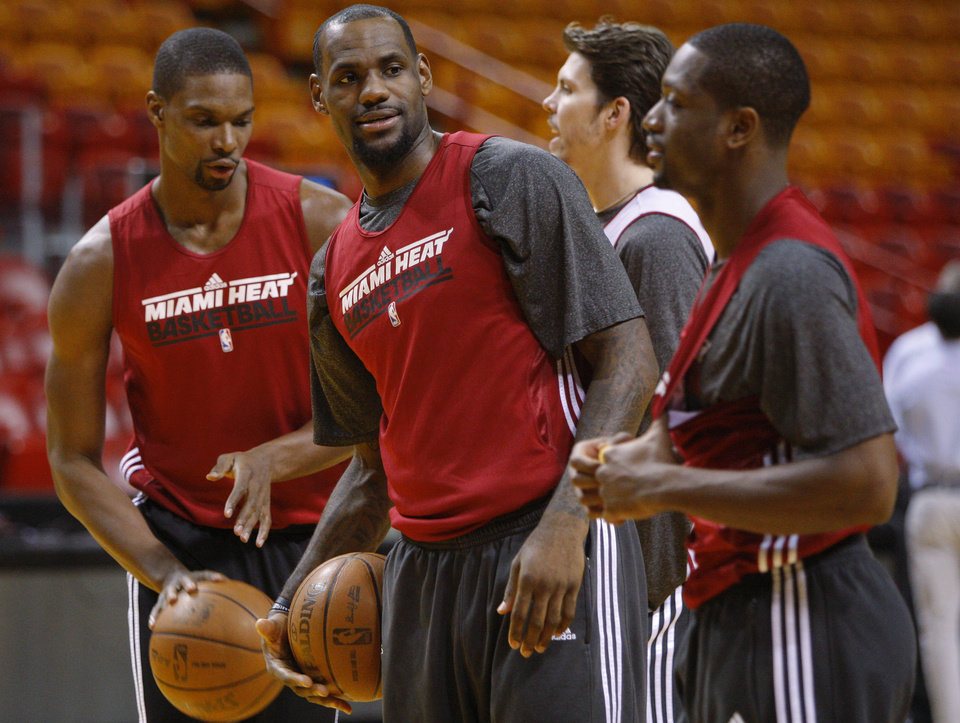 Miami\'s LeBron James, center, Chris Bosh, left, Mike Miller, and Dwyane Wade gather during a practice for Game 5 of the NBA Finals between the Oklahoma City Thunder and the Miami Heat at American Airlines Arena, Wednesday, June 20, 2012. Photo by Bryan Terry, The Oklahoman