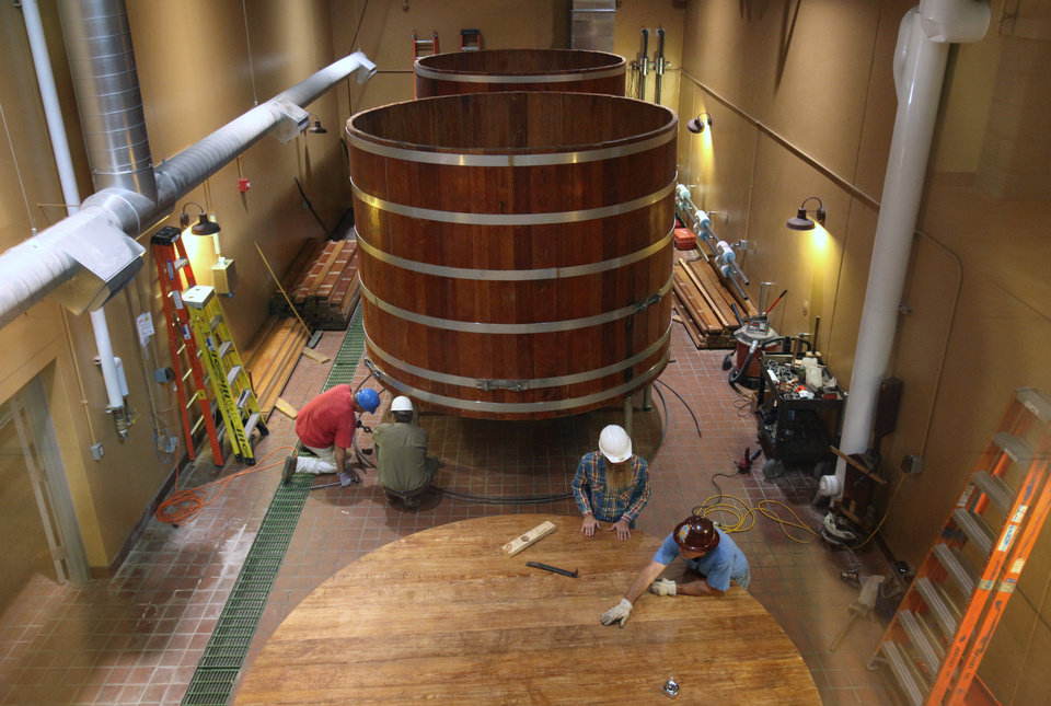 Photo - FILE - In this Aug. 15, 2013, file photo, Three 100-year-old fermentation barrels from Detroit's Stroh's brewery are assembled at Bell's Brewery in Comstock for making lager beer, in Kalamazoo, Mich. Bell's Brewery said it plans to open a new pub the week of Monday, Sept. 16, 2013, at Gerald Ford International Airport in Grand Rapids. It will be similar to but smaller than Bell's Eccentric Cafe in Kalamazoo. (AP Photo/Kalamazoo Gazette/m.live media group, Mark Bugnaski, File)