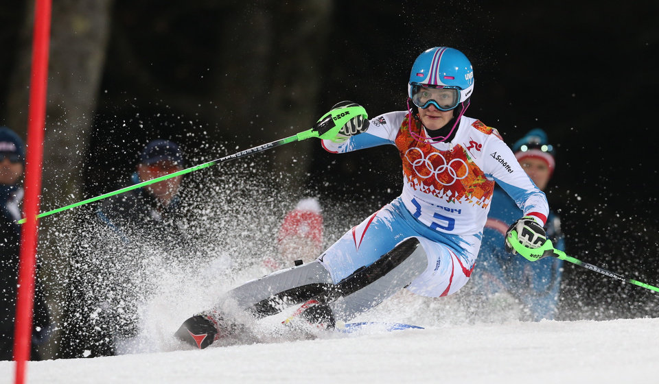 Photo - Austria's Kathrin Zettel skis in the second run of the women's slalom to win the bronze medal at the Sochi 2014 Winter Olympics, Friday, Feb. 21, 2014, in Krasnaya Polyana, Russia. (AP Photo/Luca Bruno)