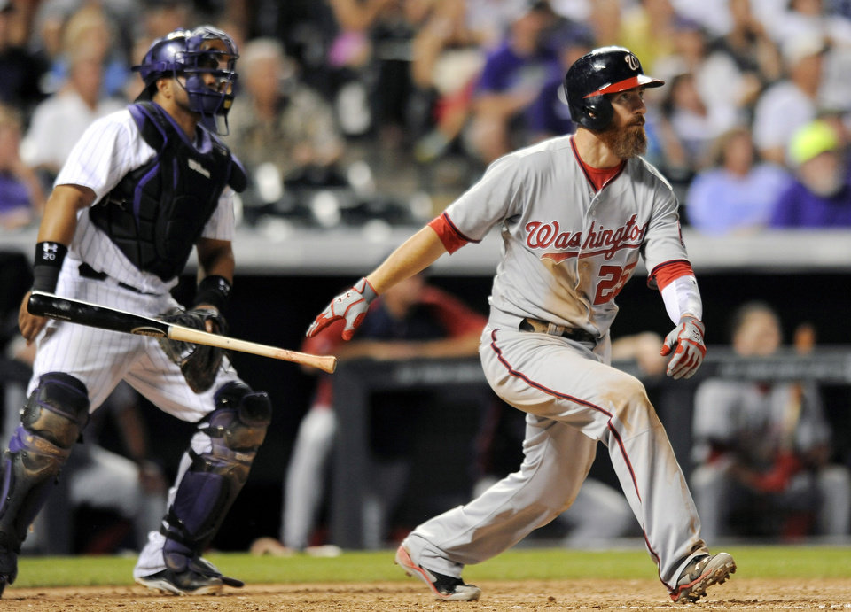 Photo - Washington Nationals first baseman Adam LaRoche hits a three-run home run in the seventh inning of a baseball game against the Colorado Rockies on Tuesday, July 22, 2014, in Denver. (AP Photo/Chris Schneider)