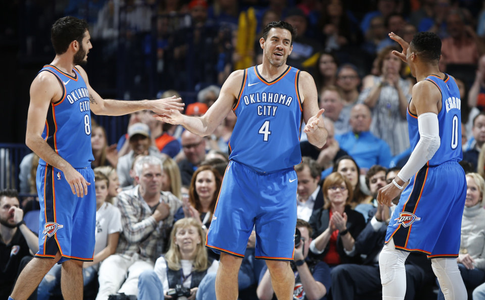 Photo - Oklahoma City's Nick Collison (4) slaps hands with Oklahoma City's Alex Abrines (8) and Russell Westbrook (0) during an NBA basketball game between the Oklahoma City Thunder and the San Antonio Spurs at Chesapeake Energy Arena in Oklahoma City, Saturday, March 10, 2018.  Photo by Bryan Terry, The Oklahoman