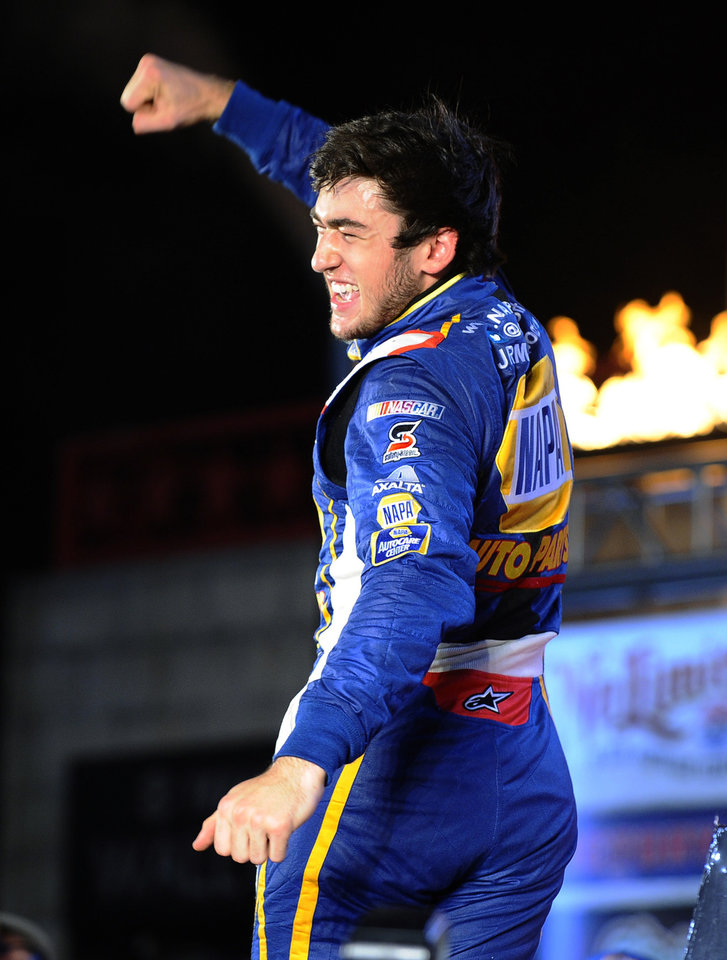 Photo - Chase Elliott celebrates in Victory Lane after winning the NASCAR Nationwide Series auto race at Texas Motor Speedway in Fort Worth, Texas, Friday, April 4, 2014. (AP Photo/Ralph Lauer)