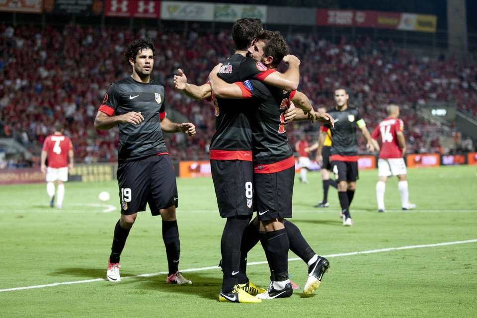 Photo -   Atletico Madrid's players celebrate a goal against Hapoel Tel Aviv during the Europa League Group B soccer match at the Bloomfield stadium in Tel Aviv, Israel,Thursday, Sept. 20, 2012. (AP Photo/Ariel Schalit)