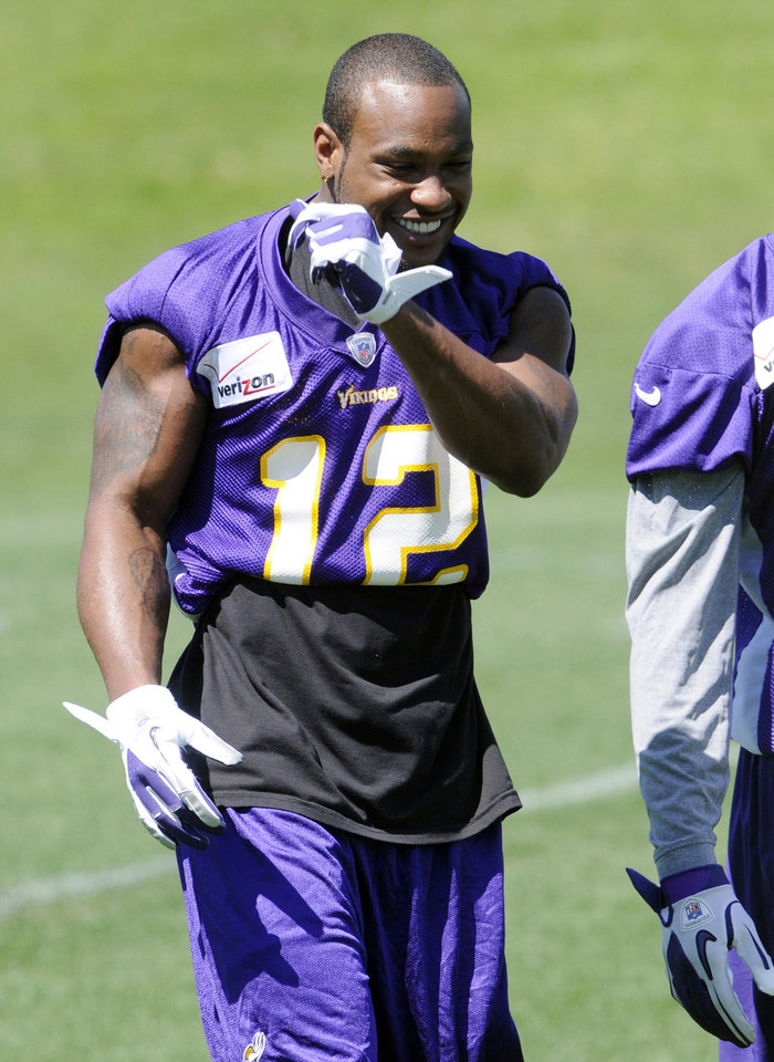Photo -   Minnesota Vikings wide receiver Percy Harvin enjoys a laugh during NFL football practice, Thursday, June 21, 2012, in Eden Prairie, Minn. Harvin has asked to be traded, saying earlier in the week he was upset with the team but not elaborating. (AP Photo/Jim Mone)